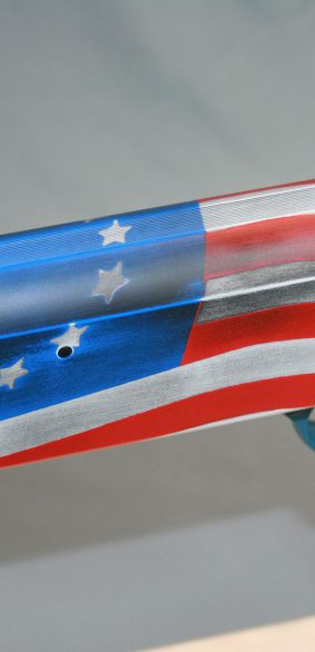 guns of alaska american flag shotgun